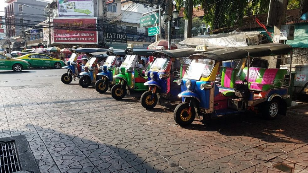 A row of tul-tuks parked in Bangkok