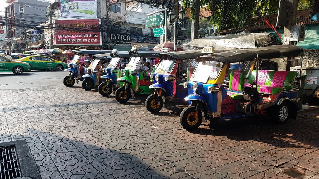A row of tul-tuks parked in Bangkok